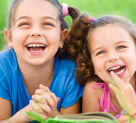 Two Young Girls Laughing Together | Pasadena Childrens Dentistry
